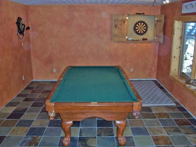 Pool table and darts in den.