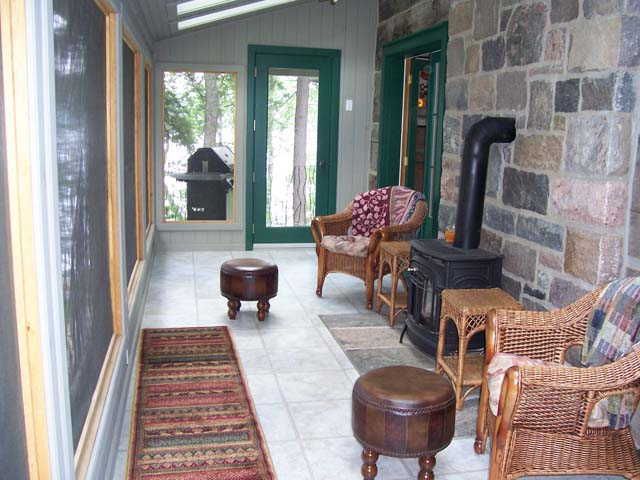 Sun room with woodstove for 3 season comfort