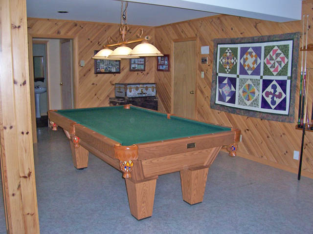 The pool table is in the recreation room.