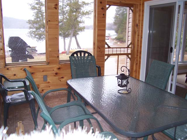 Screened room opens onto the deck.