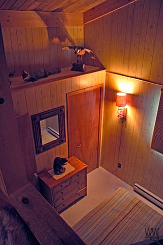 View from loft to bedroom below.  There is a gate on the entrance to the loft.