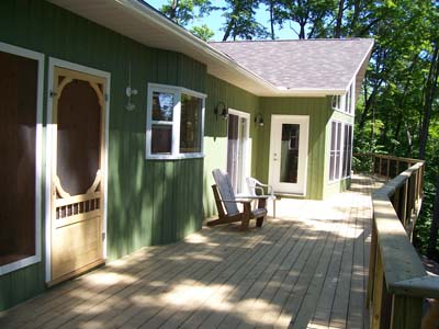 Cottage is nestled into the trees for added privacy.