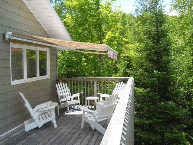 Private deck with canopy for shade.