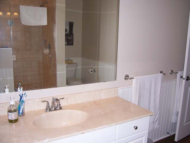 Ensuite bathroom on main level of cottage.