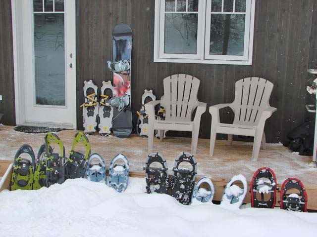 Four sets of snowshoes are provided.