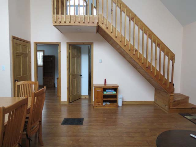 Stairs to loft.  Open ceiling ensures heat rises to the loft.