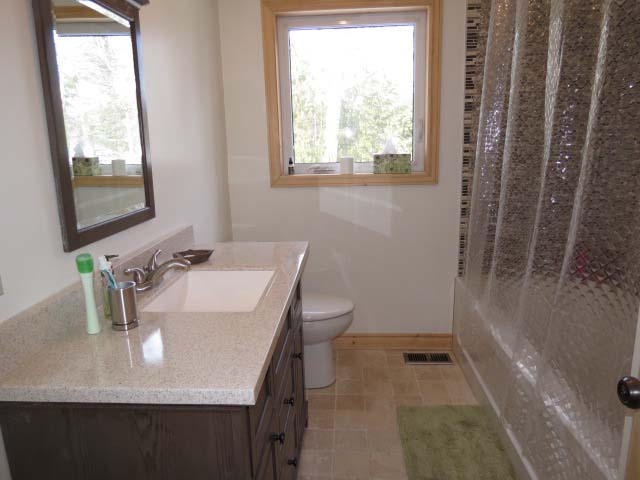 Bathroom #1 with tub and shower.
