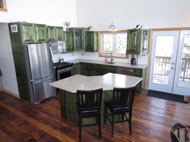 Kitchen is open concept to living/dining areas.