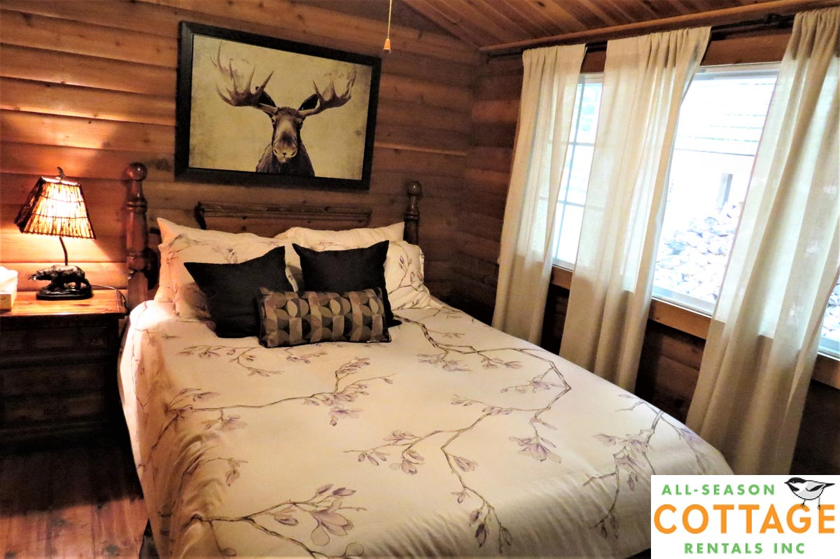 Bedroom #2 is located on main floor of cottage with a Queen bed