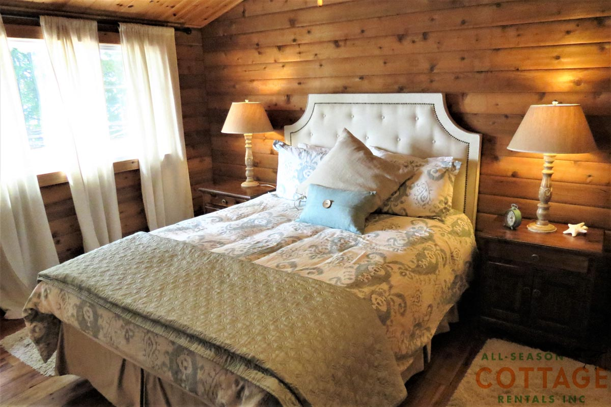 Bedroom #3 is located on main floor with a Queen bed and lakeview.