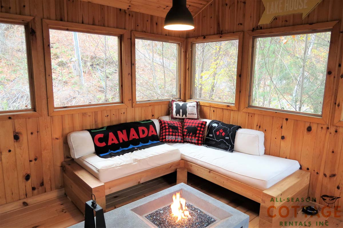 Three season room overlooks lake and has a gas fire