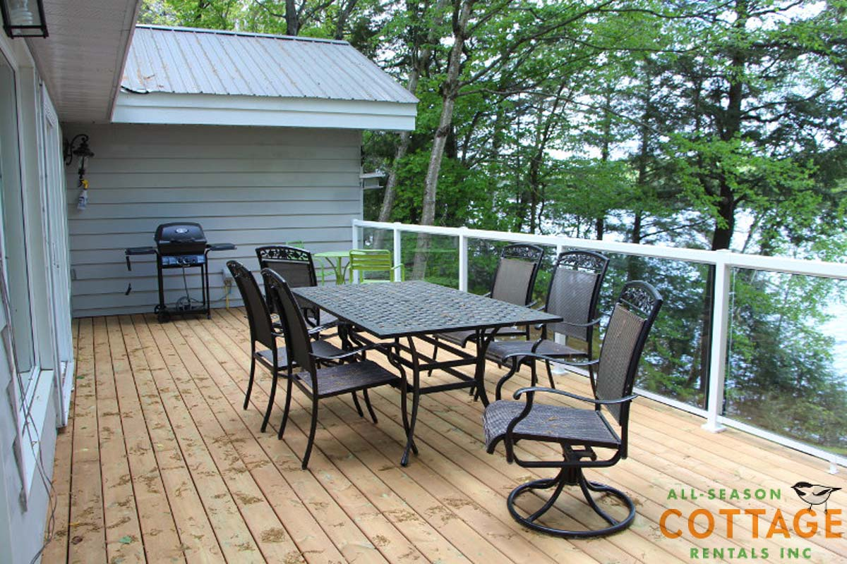 Large deck with dining table