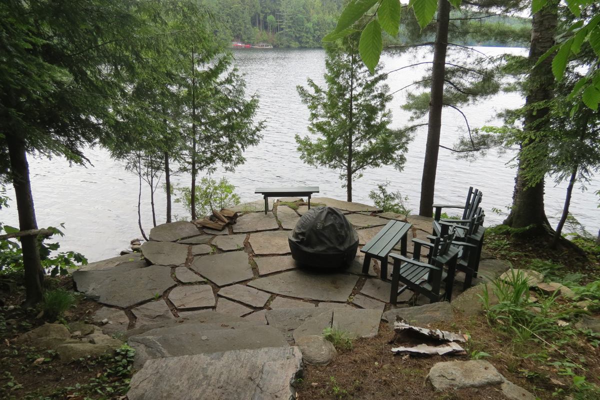 Fire pit with stairs down to the lake