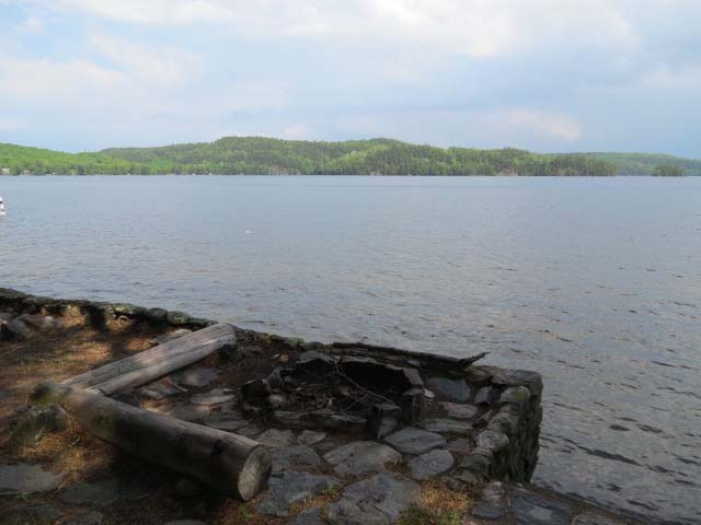 Fire pit overlooks the lake.
