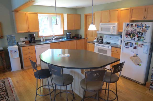 Kitchen is open concept to dining and living areas