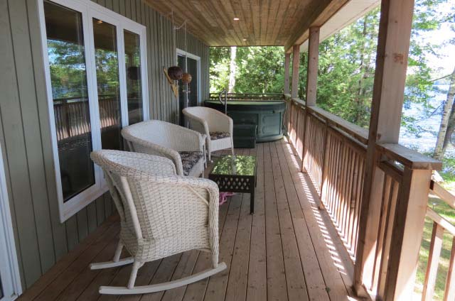 Notice the hot tub at the far end of the porch