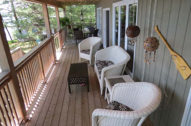 Covered porch runs the entire length of the cottage