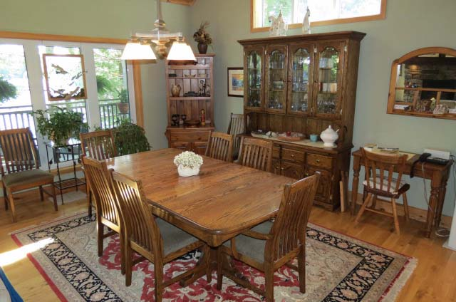 Dining room table seats 8-10.
