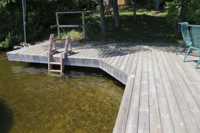 Shallow water with sand bottom around the dock.  Ladder for easy access.