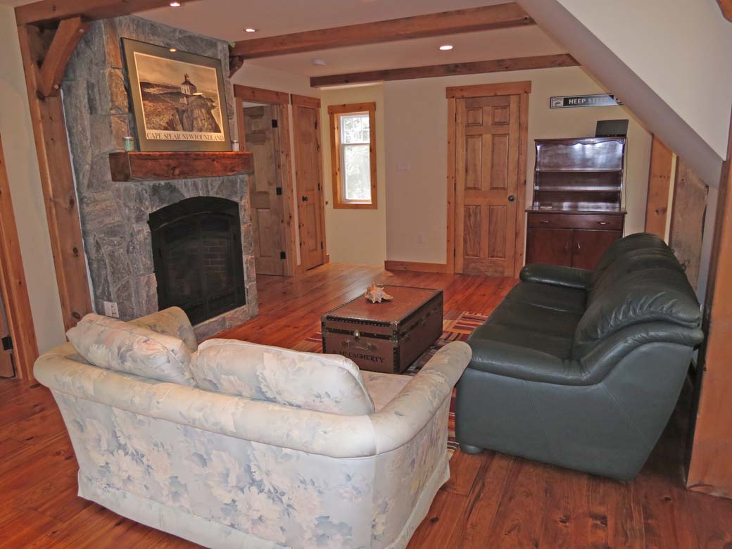 Bunkie living room with fireplace