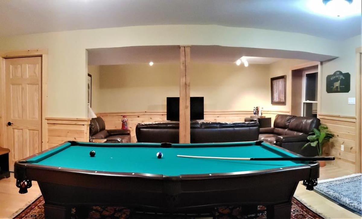 Downstairs den features comfortable TV area as well as pool table (there is also a ping-pong topper for pool table)