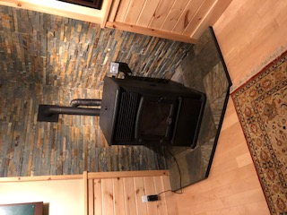 Pellet stove in the basement (operates with the click of a button)