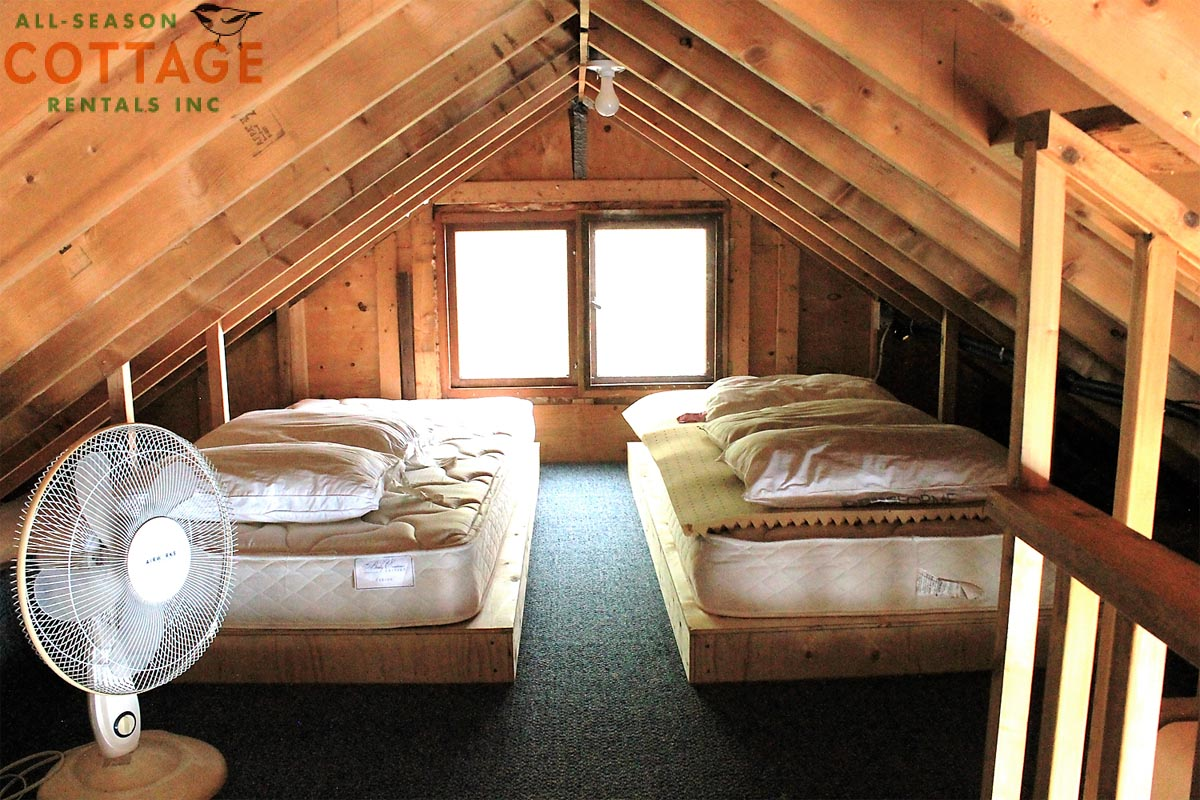 There are a total of 4 single beds in the loft