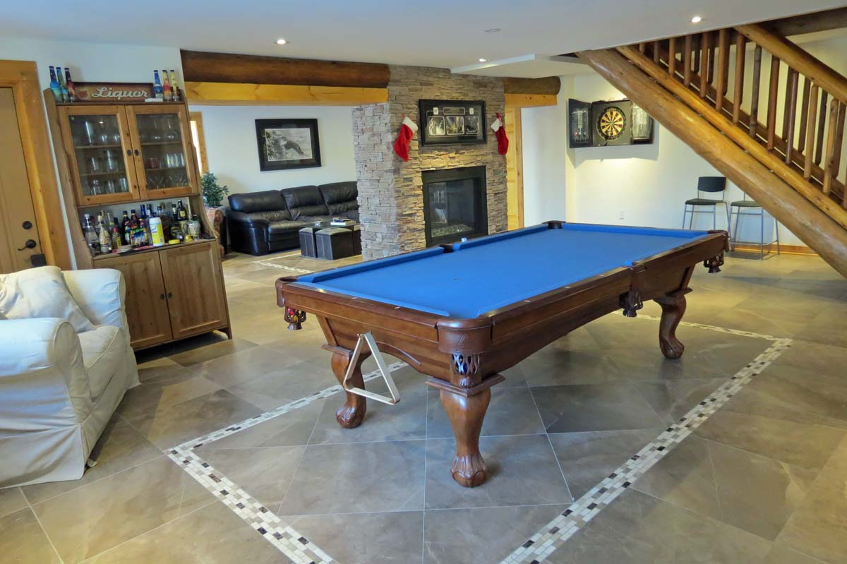 Bottom floor is devoted to games and entertainment with a pool table and dart board
