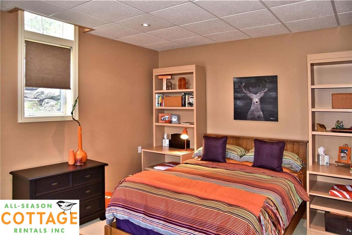 Bedroom #4 is located in lower level with a Queen bed
