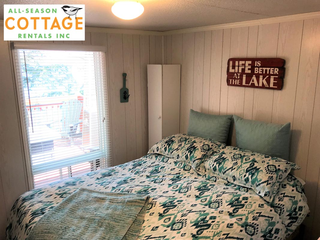 Bedroom #1 is on main floor with a Queen bed and lake view