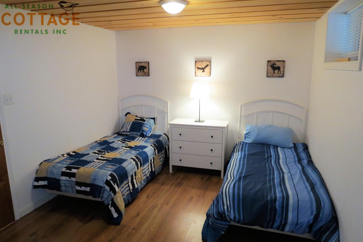 Bedroom #4 is located downstairs with two single beds