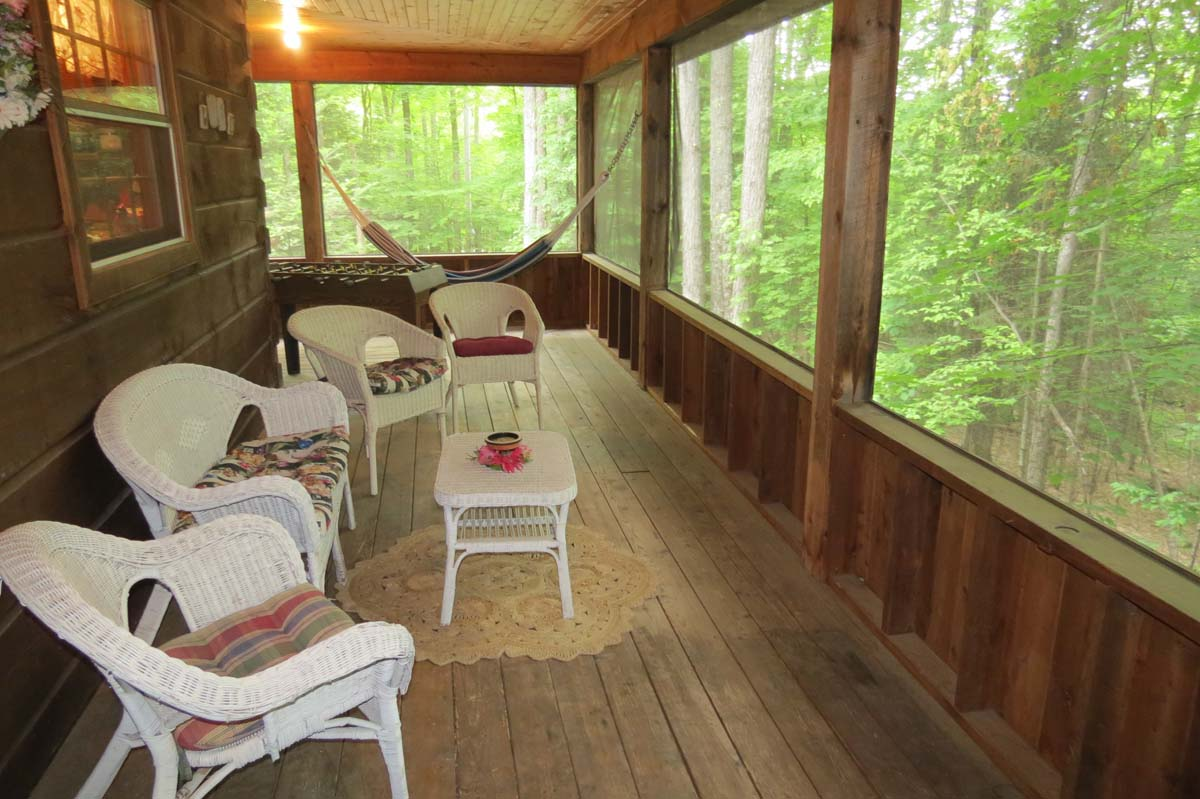 Two sides of the cottage are screened porch