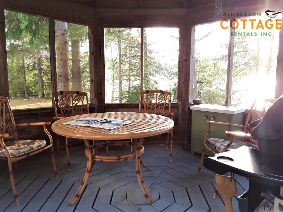 There is a table and chair se inside gazebo