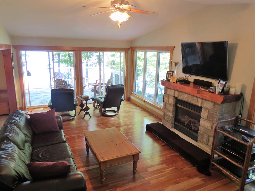 Large TV and propane fireplace in the sunroom