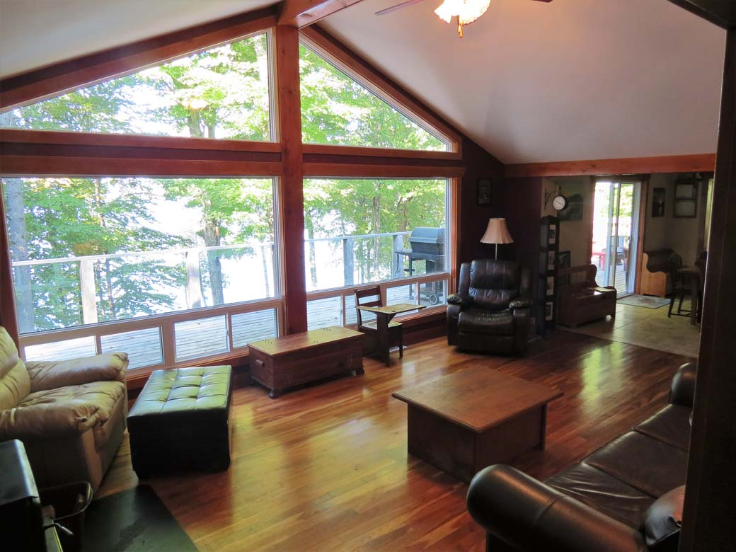 Large windows in living room provide a spectacular view of the lake.