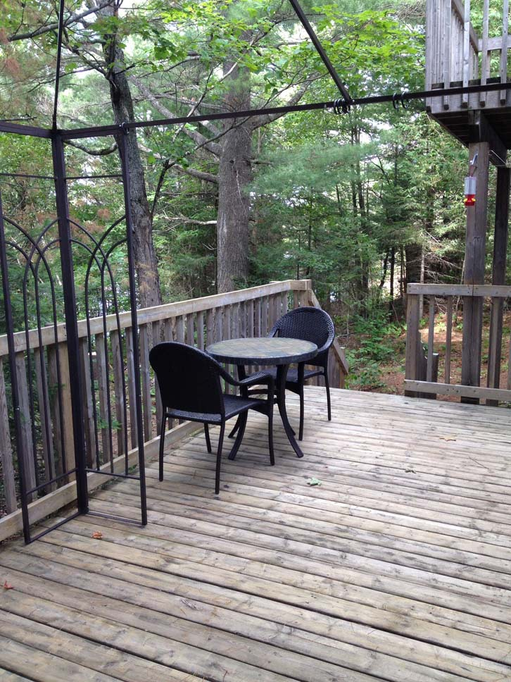 Deck has two bistro tables