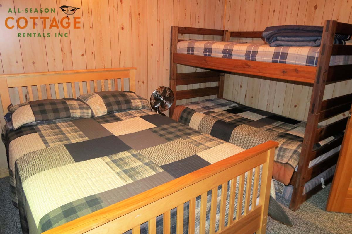 Bedroom #3 is located downstairs with a Double, plus Single/Single bunks