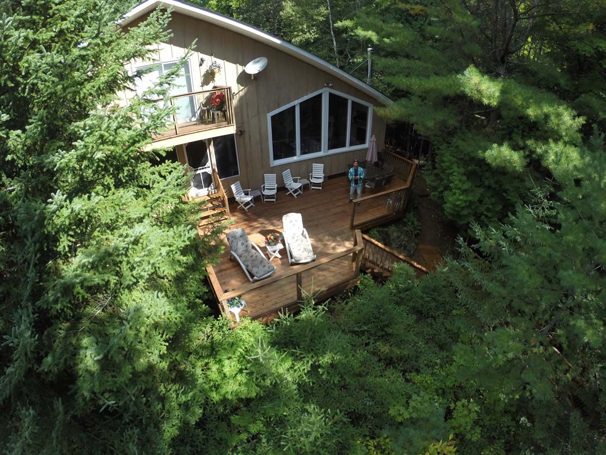 Aerial view showing large deck and private bedroom balcony
