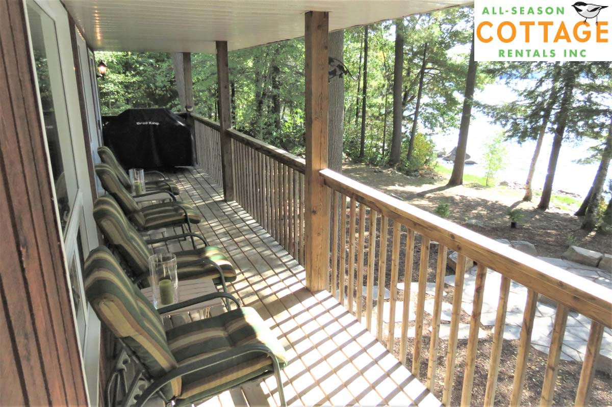 Deck runs length of cottage, is enclosed, and only accessed from inside the cottage.