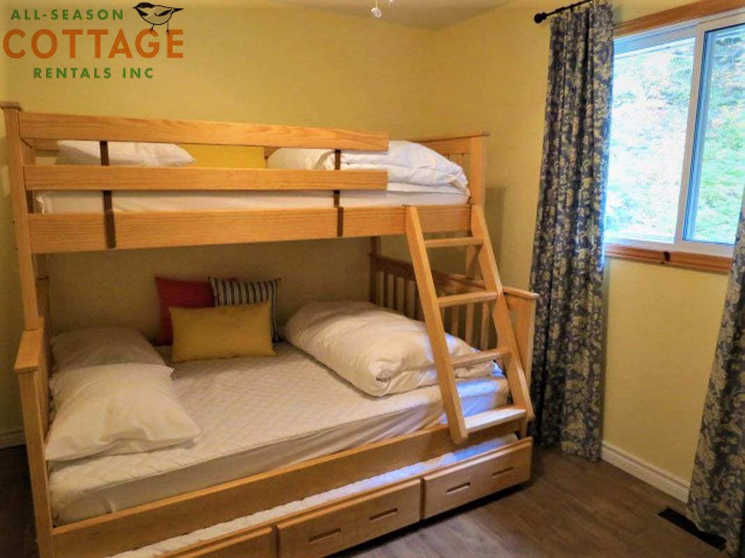 Bedroom #2 on main floor.  There is a trundle bed under the bottom bunk.