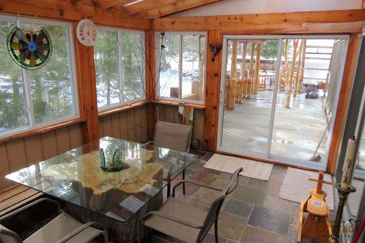 Sunroom leads out to covered deck (awesome to enjoy during the Spring ski season)
