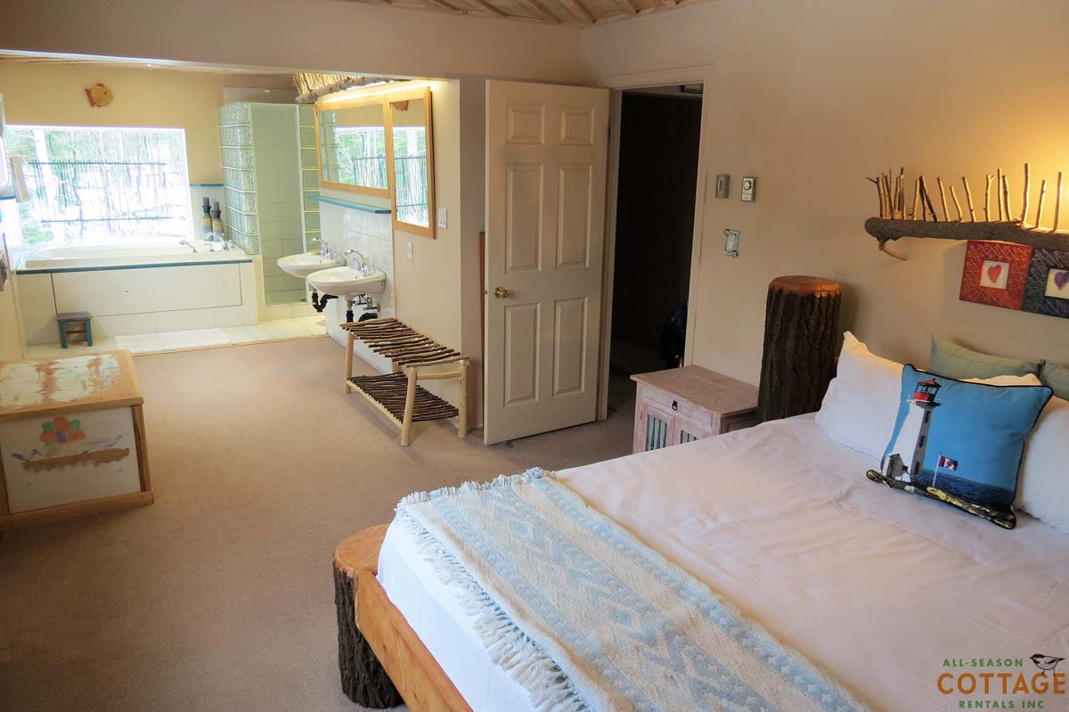 Master bedroom has a large ensuite with jacuzzi tub, shower and two sinks