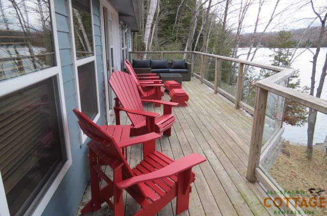 Deck  runs along 2 sides of the cottage