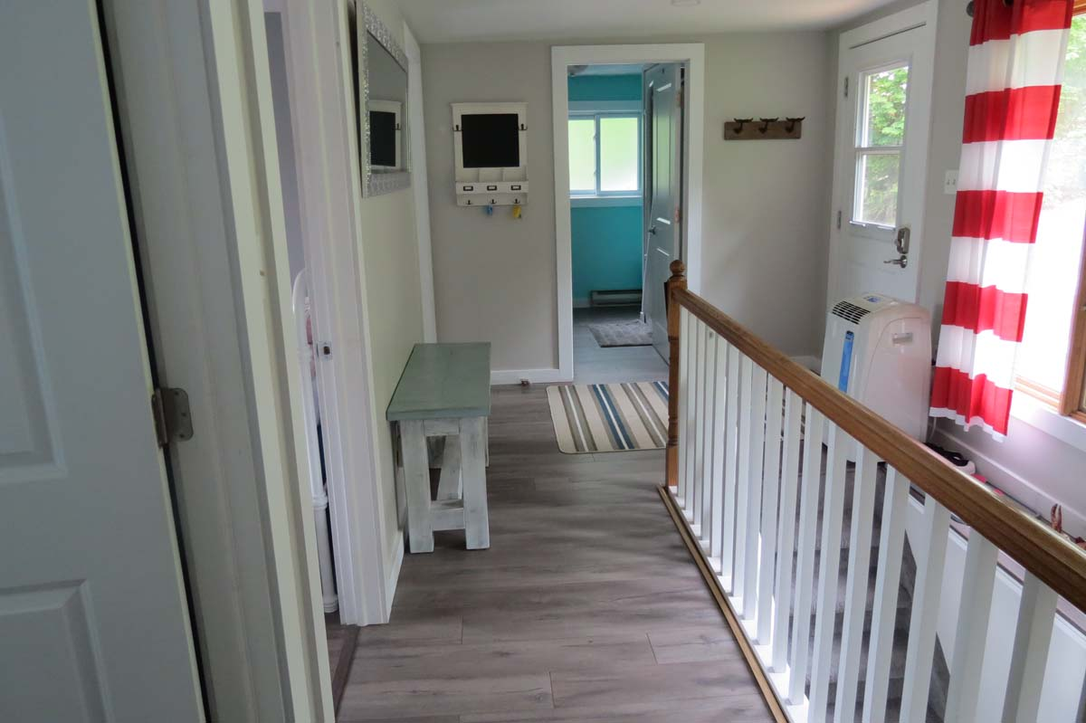 Front door and hallway leading to the bedrooms