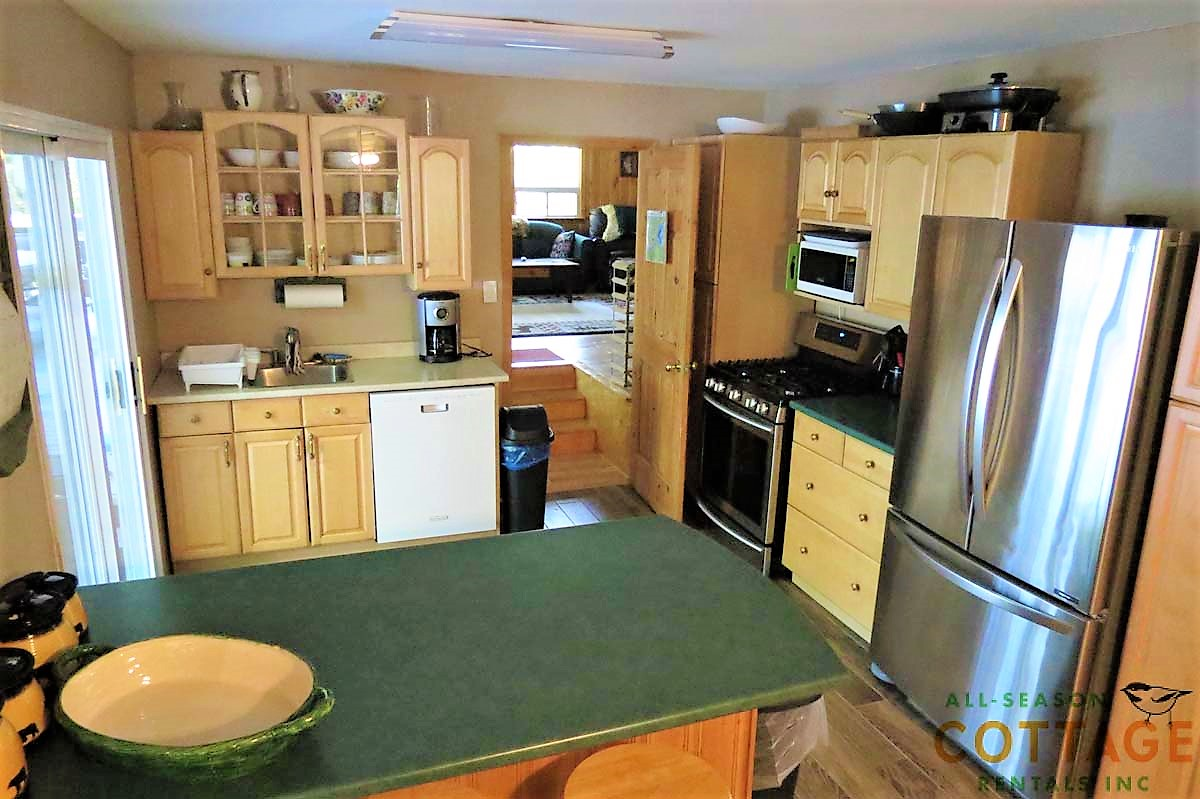 Kitchen is centrally located with large sliding doors to walk out to deck