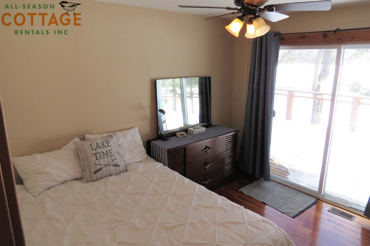 Bedroom #1 is on main floor with Queen bed and ceiling fan (plus great view of the lake!)
